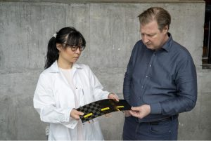 Dr Johanna Xu and Leif Asp, scientists from Chalmers University in Sweden, examine a newly manufactured structural battery cell
